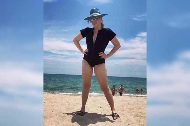 Rebel Wilson wearing a plunging swimsuit