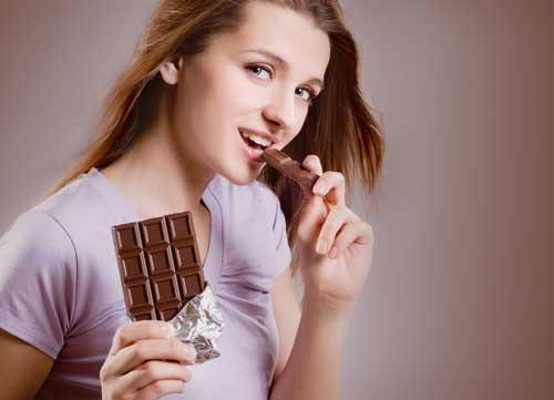 lady eating dark chocolate