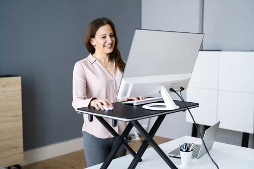lady using standing desk